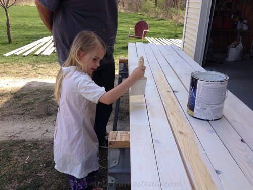 painting the picket fence boards | ASimpleHomestead.com
