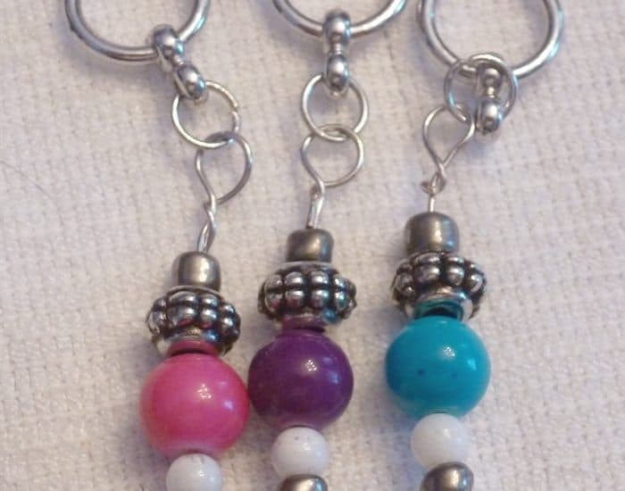 pink, purple and turquoise stitch markers