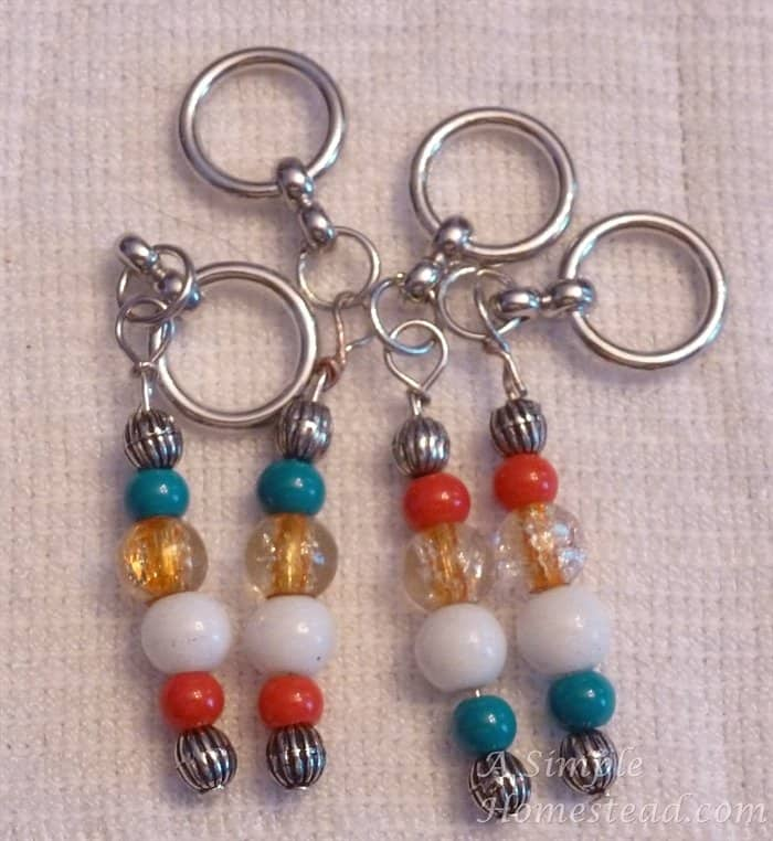 red and turquoise stitch markers