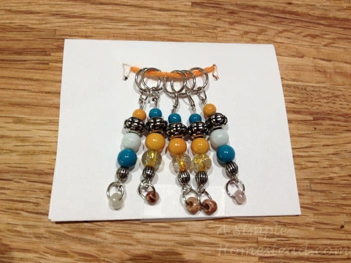 ASimpleHomestead.com - orange and turquoise stitch markers