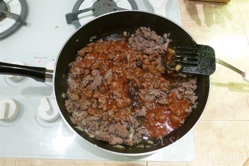 ASimpleHomestead.com - bbq hamburger - sauce in pan