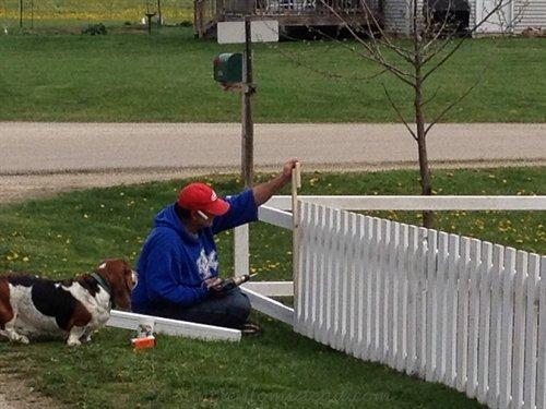 Papa building the garden fence | ASimpleHomestead.com